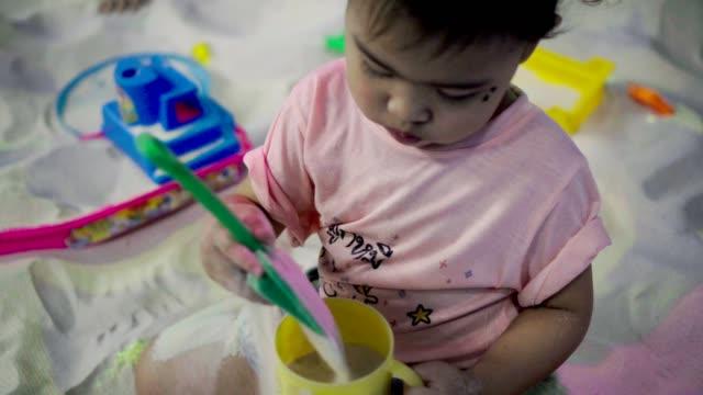 Little-girl-playing-in-a-sandbox