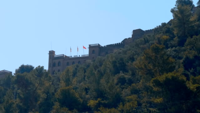 Medieval-castle-on-top-of-a-wooded-mountain-in-the-Spain