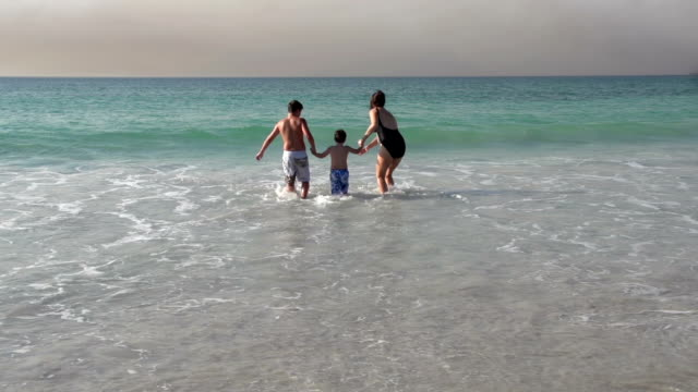 Mother-and-2-children-running-into-the-sea-Cape-Town-South-Africa