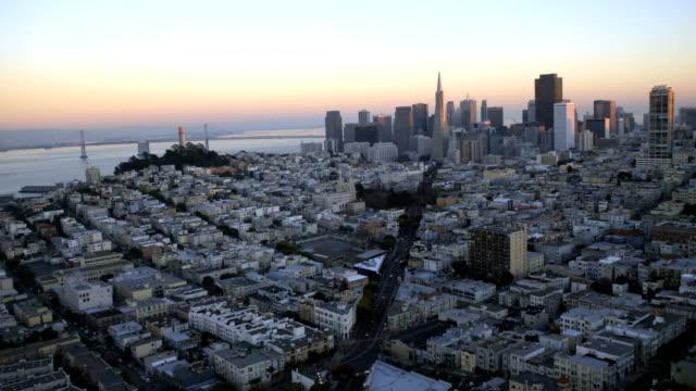 Aerial-sunset-city-Skyscrapers-Wharf-area-San-Francisco