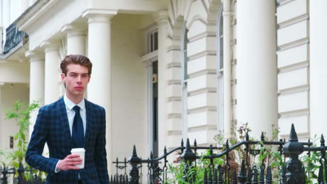 Stylish-Young-Man-Carrying-Coffee-Walking-On-City-Street