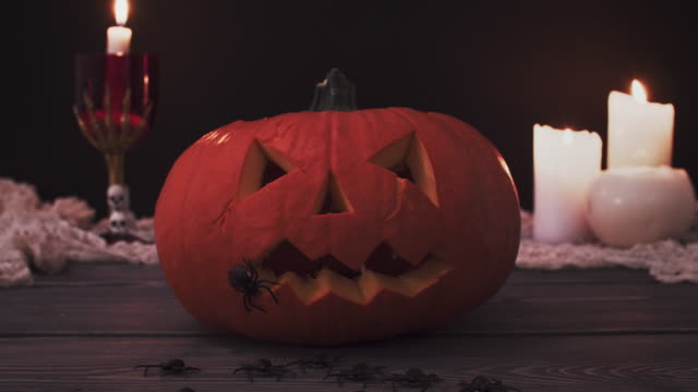 Halloween-pumpkin-with-burning-candles