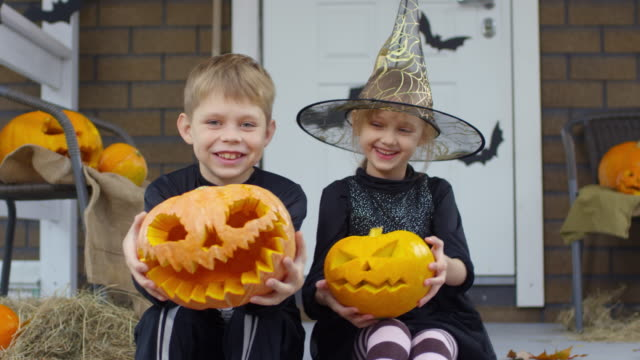 Kids-in-Halloween-Costumes-Laughing-and-Posing-for-Camera-Outdoors