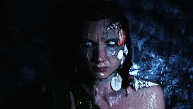 4k-Halloween-Shot-of-a-Horror-Woman-Mermaid-and-Water-Pouring-on-her-Head