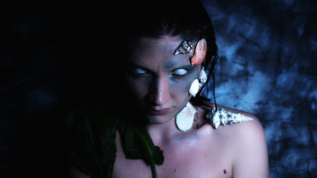 4k-Halloween-Shot-of-a-Horror-Woman-Mermaid-Posing-Nude-with-White-Eyes