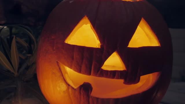 Candle-Flickers-inside-a-Jack-o-lantern-Pumpkin