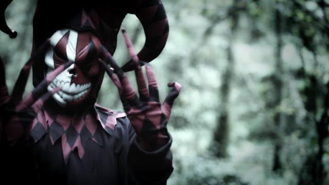 4k-Halloween-Shot-of-a-Child-in-Joker-Costume-Showing-Creepy-Fingers