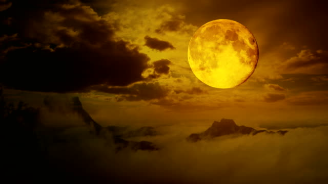 Halloween-footage-:-Timelapse-Dramatic-sky-with-tree-full-moon-and-clouds-over-mountain-Cool-blue-tone-uhd-4k-