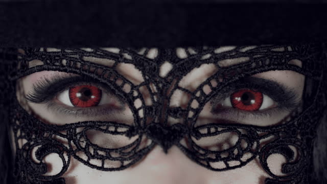 4k-Halloween-Shot-of-a-Witch-Extreme-Close-up-of-Red-Eyes-with-Mask