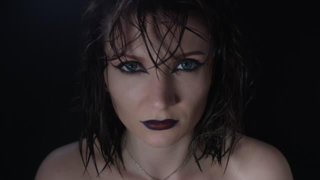 4k-shoot-of-a-horror-Halloween-model---Vampire-putting-crown-on-head