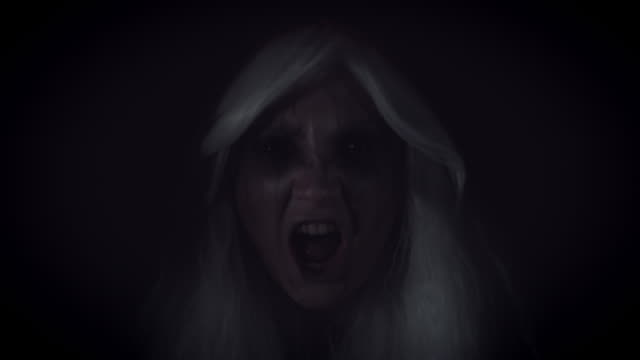 4K-Horror-Witch-Appearing-from-Darkness-Screaming