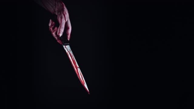 4K-Horror-Creepy-Woman-Hand-with-Knife-Bleeding