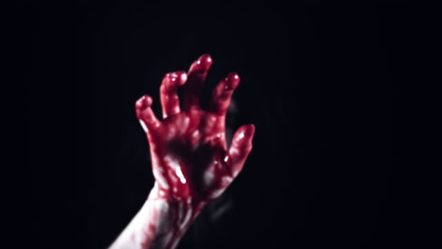 4K-Horror-Creepy-Woman-Showing-Bloody-Hand