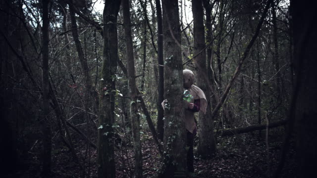 4K-Horror-Scarecrow-with-Sackcloth-Mask-Hiding-in-Forest