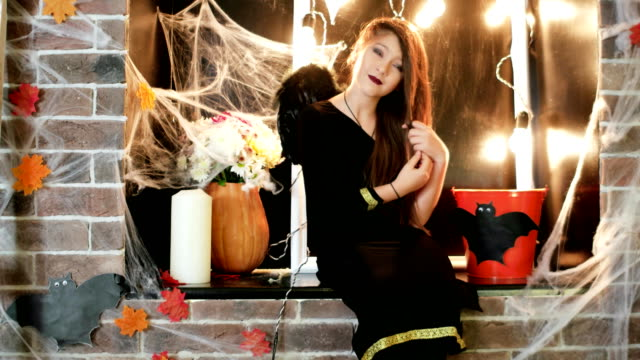 halloween-celebration-young-witch-preraring-to-horror-party-teen-wearing-costume-trick-or-treat