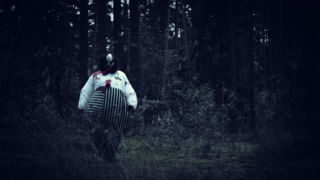 4K-Halloween-Horror-Clown-in-Forest-Walking