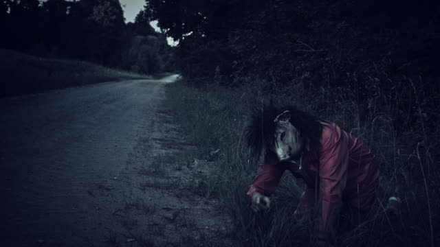 4K-Halloween-Horror-Man-with-Pig-Mask-Crawling