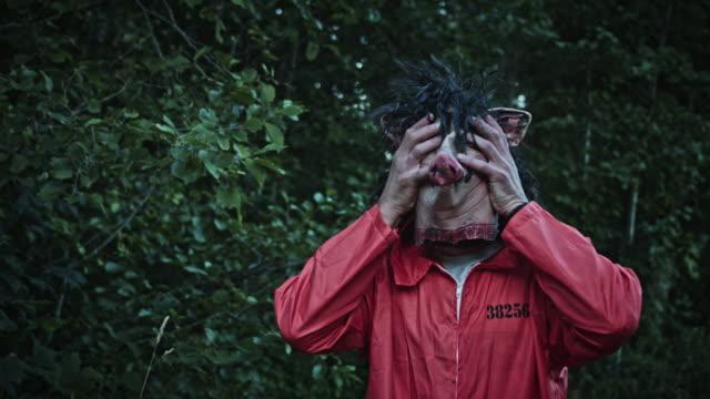 4K-Halloween-Horror-Man-Taking-Pig-Mask-Off