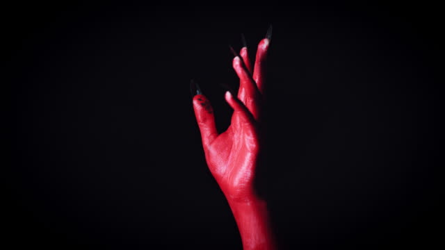 Mano-de-4-k-Horror-diablo-mostrando-el-dedo-medio