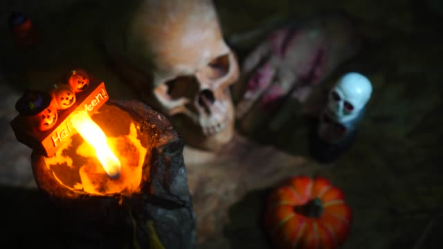Halloween-day-footage-with-skull-pumpkin-candle-light-and-movement