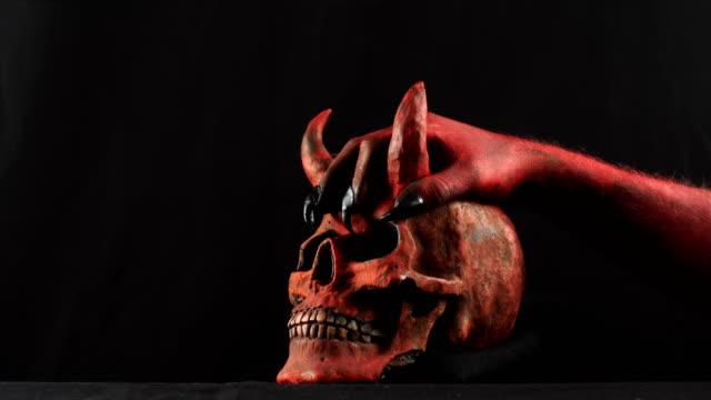 Red-demon-hand-touching-red-demon-skull-50-fps
