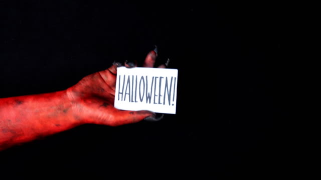 Mano-roja-demonio-tarjeta-de-halloween-50-fps