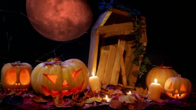 Cementerio-de-Halloween-sangre-de-luna-y-gato-o-linterna