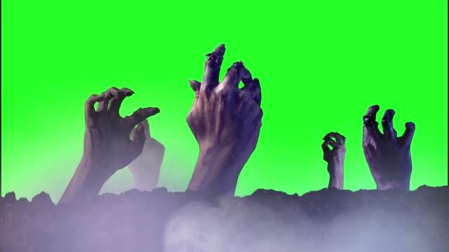 Zombie-de-la-mano-sobre-un-fondo-verde-para-Halloween