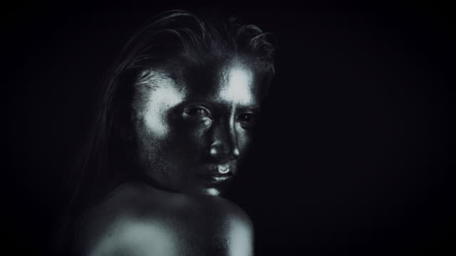 4K-Horror-Woman-with-Silver-Metallic-Make-up-Looking-Evil