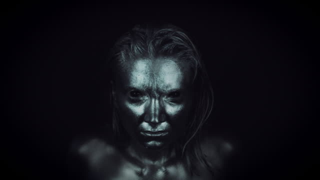 4K-Horror-Woman-with-Silver-Metallic-Make-up-Moving-fast-to-Camera