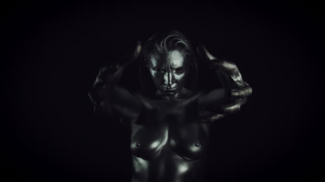 4K-Horror-Woman-with-Silver-Metallic-Make-up-Holding-Hands-infront