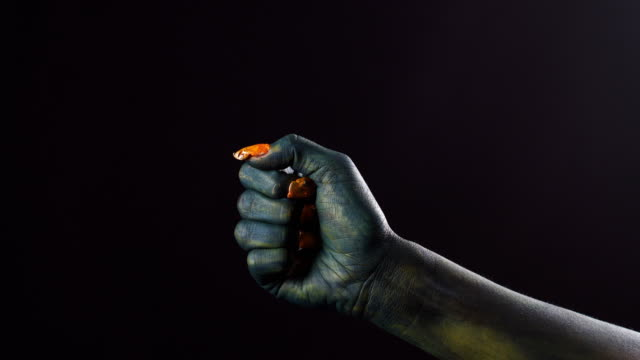 Green-hand-of-troll-makes-dislike-sign-50-fps