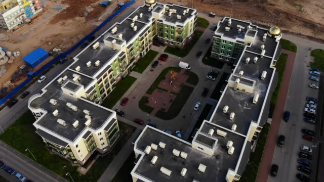 Aerial-panorama-on-modern-apartment-complex-and-construction-site-