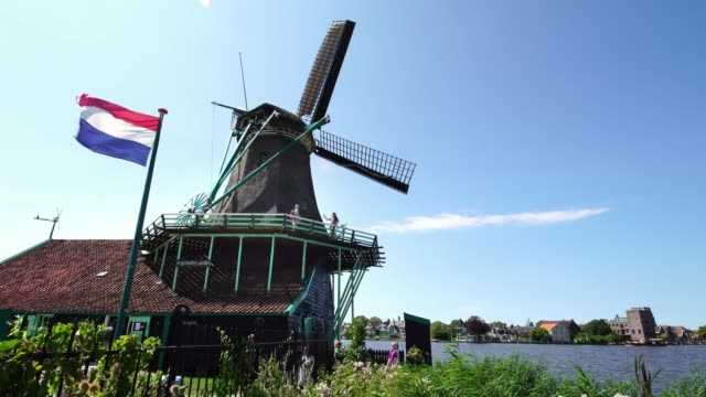 Tourists-taking-pictures-of-traditional-historic-Windmills-at-the-Zaanse-Schans-near-Amsterdam-Holland