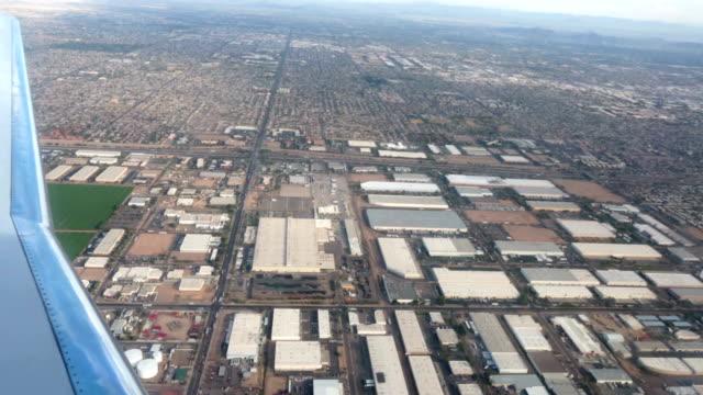 Aerial-airline-approach-Phoenix-Arizona-industrial-area-HD