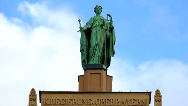 Beautiful-statue-of-Lady-Justice-atop-municipal-building-in-Munich-Germany