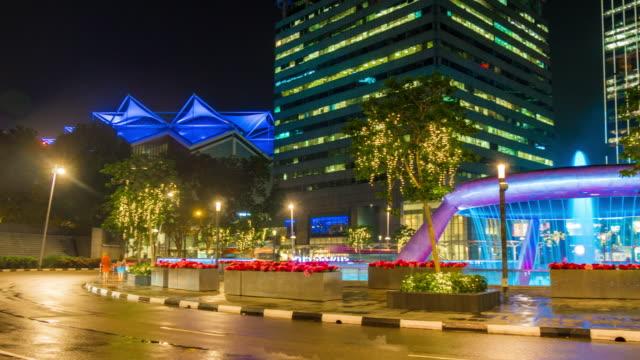 Singapur-echte-Nacht-Licht-Kreisverkehr-Suntec-Einkaufszentrum-Stadtpanorama-4k-Zeitraffer