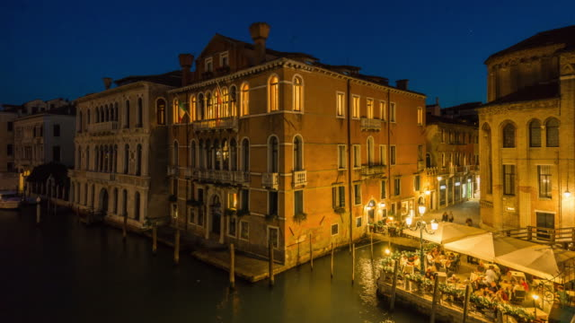 italy-night-illumination-famous-venice-city-canal-ponte-dell-academia-side-bay-cafe-view-4k-time-lapse