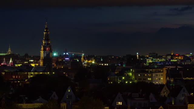 Países-Bajos-noche-vida-amsterdam-ciudad-techo-superior-panorama-4k-lapso-de-tiempo