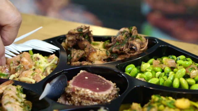 Cold-dish-seafood-and-salad-platter-in-Europe-open-market-shot-in-slow-motion-120-fps