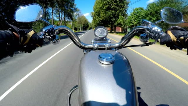 Riding-a-motorcycle-Biker-rides-on-the-road-with-a-first-person-