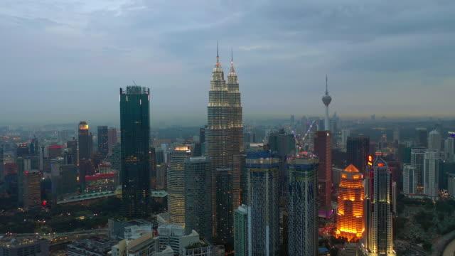 sunset-twilight-illumination-kuala-lumpur-downtown-aerial-panorama-4k-malaysia
