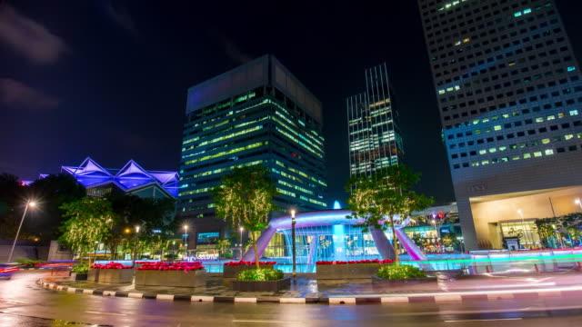 ciudad-de-suntec-de-Singapur-noche-tráfico-fuente-círculo-4k-lapso-de-tiempo