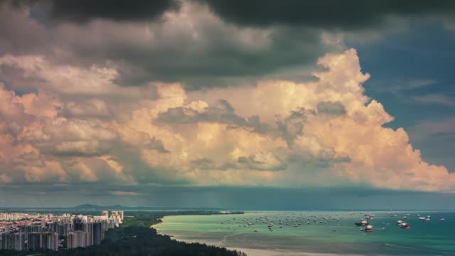 Costa-de-Singapur-al-atardecer-soleado-cielo-4k-lapso-de-tiempo