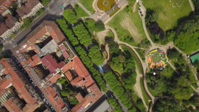 italy-sunny-day-milan-city-blocks-park-side-aerial-down-view-4k