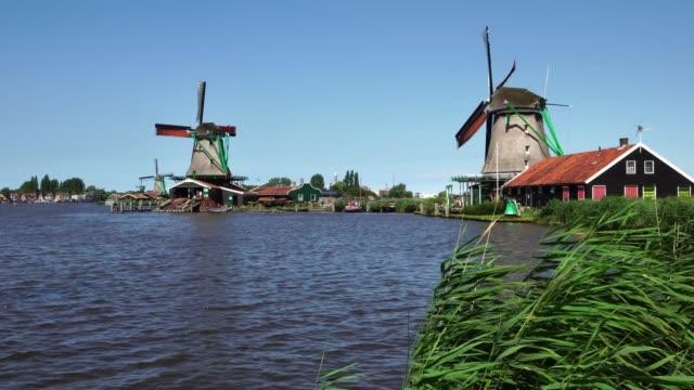 Traditional-windmills-Zaanse-Schans-in-Zaandam-tourist-destination-near-Amsterdam-Netherlands
