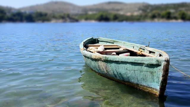 old-fishing-boat-on-sea
