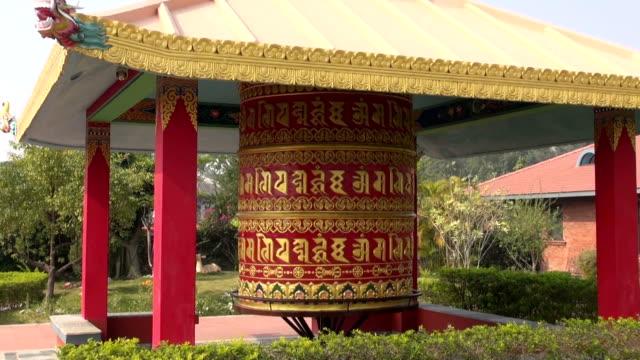 beautiful-buddhist-prayer-wheel-in-Lumbini-Nepal