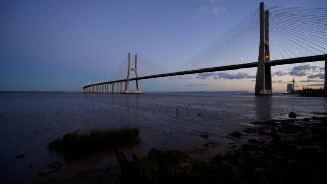 Ponte-Vasco-da-Gama-Bridge-view-near-the-Rio-Tejo-river-after-sunset