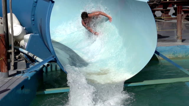 Slow-motion-of-happy-boy-on-water-slide-South-Africa